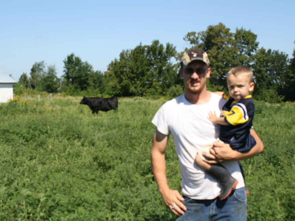 justin with son and cow-cropped